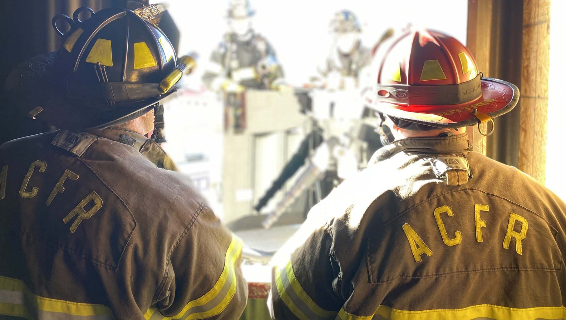 Two ACFR firefighters look on during a training exercise