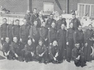 Black and white photo of ACFR staff from the 1950's
