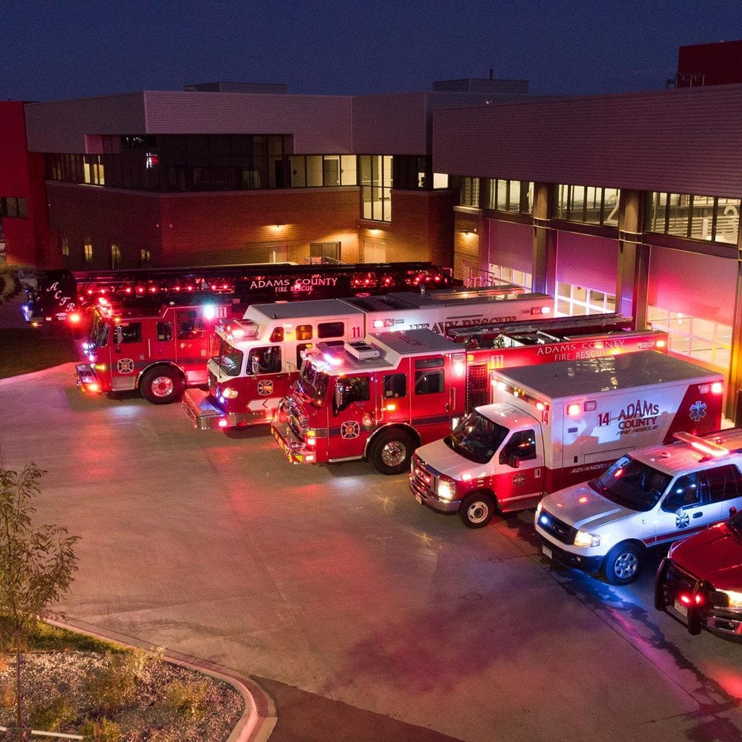 An aerial view of ACFR apparatus parked in front of an ACFR station